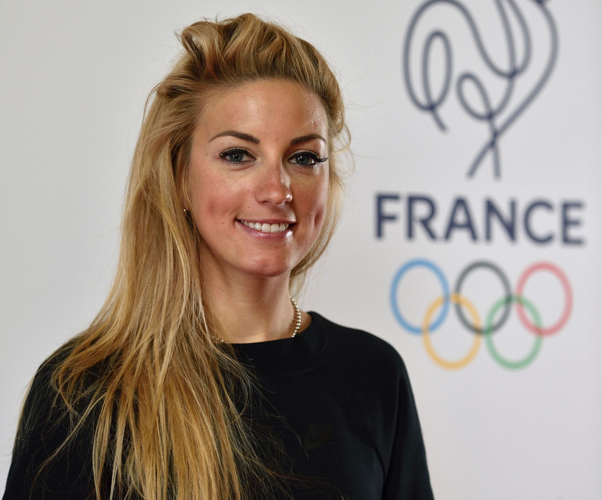 French cyclist Pauline Ferrand-Prevot poses on April 27, 2016, at the Palais Chaillot in Paris, during the French Olympic team's launch of their 100-day countdown to the opening of the 2016 Rio Olympic Games on August 5. / AFP PHOTO / ERIC FEFERBERG